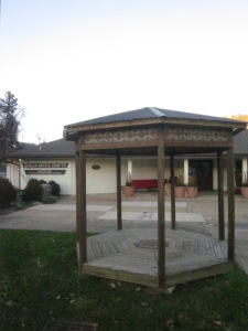 Look at the weaving around the top of the gazebo and the woodwork in the floor.