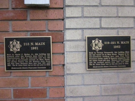 These are signs you'll see on historic buildings along Main Street providing details of their past.