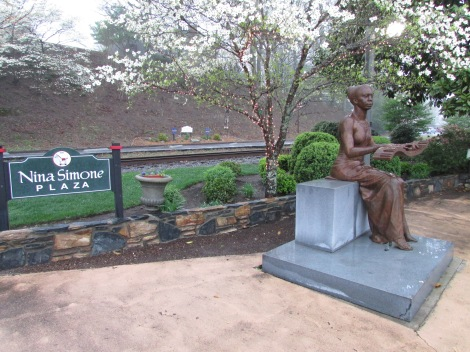 This is the exquisite sculpture located across from Upstairs Artspace and the theater on Trade Street in Tryon.